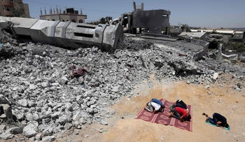 Palestinian Muslim worshippers pray near the rubble of mosque destroyed in an Israeli bombing in Beit Lahia, in the northern Gaza Strip, last week.