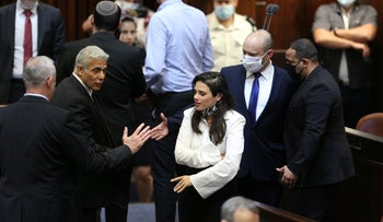 Yesh Atid's Yair Lapid (L), Yamina's Ayelet Shaked (C) and Naftali Bennet (R), in the Israeli Knesst in Jerusalem, earlier this week.