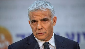 Yesh Atid chairman Yair Lapid speaks during a news conference in Tel Aviv last month.