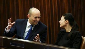 Yamina party leader Naftali Bennett, left, speaks to Labour party leader Merav Michaeli, Knesset, June 2021.