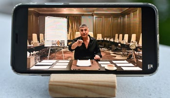 A photograph taken last month in Istanbul shows on a mobile phone Sedat Peker speaking on his youtube channel