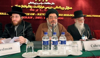 Iranian top cleric Ali Akbar Mohtashamipour, center, speaks at a conference on the Holocaust, in Tehran, Iran, 2006