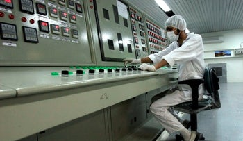 A technician works at the Uranium Conversion Facility just outside the city of Isfahan, Iran.