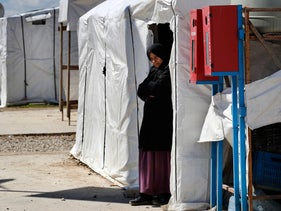 A Syrian woman in a refugee camp in Lebanon in March.