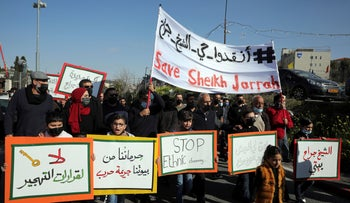Palestinians march to protest Israeli demolition of Palestinian homes in the Sheikh Jarrah neighborhood in Jerusalem, three months ago.