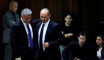 Yair Lapid and Naftali Bennett walk together in the Knesset in 2013
