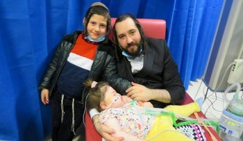 Alta is seen with her brother Tzvi and father Abraham, in Manchester, Britain, in this undated picture obtained from social media.