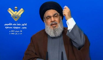 Hassan Nasrallah delivering a televised speech on Hezbollah's al-Manar TV on Tuesday.