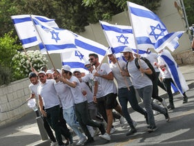 People march with Israeli flags in Jerusalem before the annual Flag March was postponed, last month.