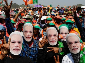 Bharatiya Janata Party (BJP) supporters wear masks of Prime Minister Narendra Modi at a rally ahead of West Bengal state elections in Kolkata, India