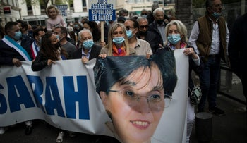 Protesters march with a banner of Sarah Halimi during a demonstration in Marseille, France in April.