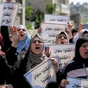 Palestinians protest Israel's planned evictions of Palestinian families from homes in Silwan, outside an Israeli court in East Jerusalem, on Thursday.