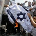 Kashmiri protesters burning an Israeli flag during a protest in Srinagar, Kashmir Valley, during the 2014 Gaza  war. The coronavirus meant the protests went online last month during the latest flare-up.