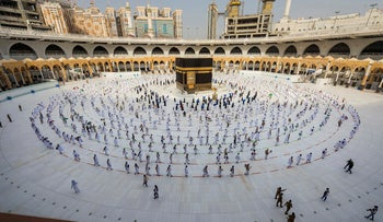 Pilgrims walk around the Kabba at the Grand Mosque in the Muslim holy city of Mecca, Saudi Arabia, last year