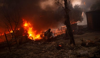 A migrant flees the Moria Camp on the Greek island of Lesbos, after a fire broke out, in September.
