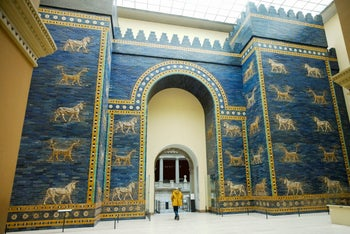 Metal restoration specialist Gert Jendritzki walks through the Babylon's Ishtar Gate as he leaves the Museum of the Ancient East in Berlin, Germany, Monday, March 15, 2021