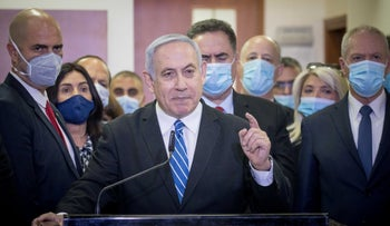 Prime Minister Benjamin Netanyahu speaks to the media at the opening of his trial at the Jerusalem District Court, last year.