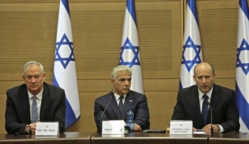 Prime Minister Naftali Bennett, gives an address while accompanied by Alternate Prime Minister and Foreign Minister Yair Lapid and Defence Minister Benny Gantz at the Knesset in Jerusalem on Sunday.
