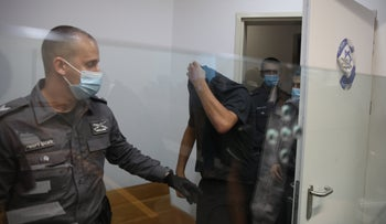 One of the suspects at the Tel Aviv Magistrate's Court, on Monday.
