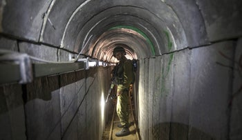 An Israeli army officer in a tunnel allegedly used by Palestinian militants for cross-border attacks, at the Israel-Gaza Border, in 2014.