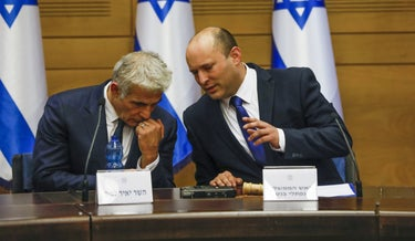 Foreign Minister Yair Lapid and Prime Minister Naftali Bennett at their first cabinet meeting earlier this week.