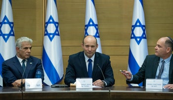 Prime Minister Naftali Bennett and Yair Lapid at the Knesset on Sunday.