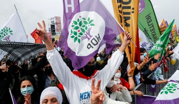 People hold pro-Kurdish HDP at an event in Istanbul, in March.