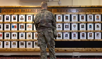 Portraits hang at a memorial to service members killed during recent years of the Iraq War in the International Zone in Baghdad, Iraq, last month.