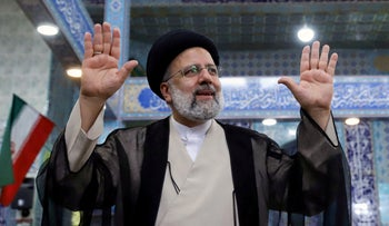 Then-presidential candidate Ebrahim Raisi after casting his vote at a polling station in Tehran, Iran, Friday.