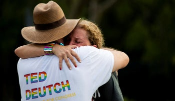 Rep. Debbie Wasserman Schultz, D-Fla., is comforted after a truck drove into a crowd of people during The Stonewall Pride Parade and Street Festival in Wilton Manors, Fla., Saturday, June 19, 2021