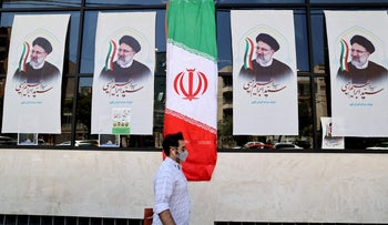 Posters of presidential candidate Ebrahim Raisi outside a campaign office in Tehran on June 7.
