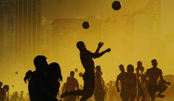 People playing ball games at Ipanema Beach, Brazil, two years ago