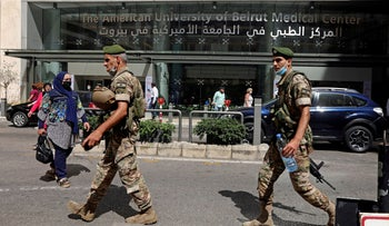 Lebanese army soldiers walk in Beirut, 2020.