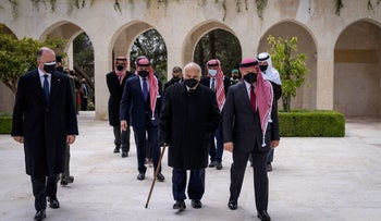 Jordan's King Abdullah II and members of the royal family including former crown prince and half-brother Prince Hamzah attend a ceremony, in Amman,  Jordan, in April.
