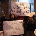 A protest against the citizenship law in Tel Aviv, featuring placards in Hebrew and Arabic.