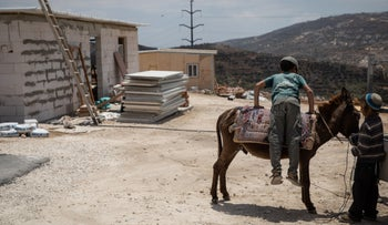The illegal outpost of Evyatar in the West Bank where IDF soldiers have helped settlers with construction of buildings, June 17, 2021