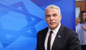 Yair Lapid arrives for the first weekly cabinet meeting of the new government in Jerusalem on Sunday