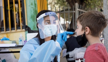A child tested for COVID-19 in a school in northern Israel, last week.