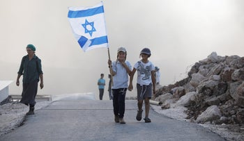 Israeli children marching in the Evyatar outpost, today.