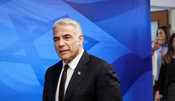 Yair Lapid arrives for the first weekly cabinet meeting of the new government in Jerusalem on Sunday.