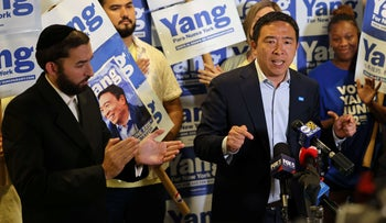 Andrew Yang speaks during a press conference with Assembly Member Simcha Eichenstein (L) in Brooklyn, Monday.