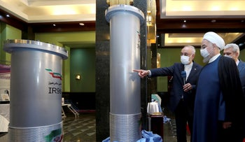 President Hassan Rouhani listens to the head of the Atomic Energy Organization of Iran while visiting an exhibition of Iran's new nuclear achievements in Tehran, Iran, in April.