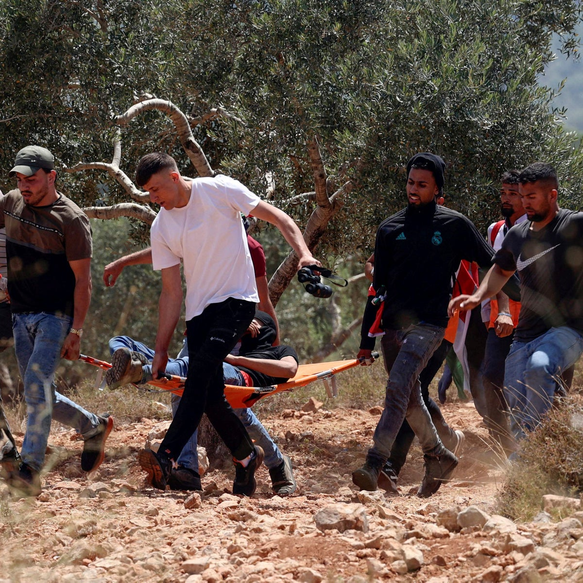 Palestinian protesters carry a wounded protester during a rally against the Evyatar outpost, two weeks ago.
