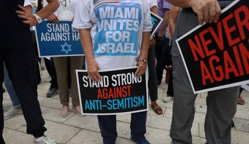 People stand together during an interfaith Rally Against Anti-Semitism, in Miami Beach, Florida, earlier this month.