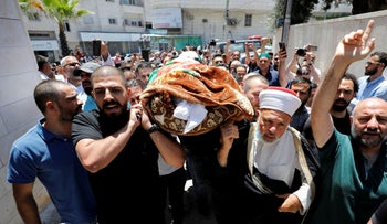 People attend the funeral of Palestinian critic Nizar Banat in Hebron, West Bank, June 2021.