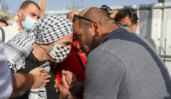 A Jewish right-wing activist and a Palestinian demonstrator face off at a protest in Sheikh Jarrah, last month.