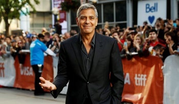 George Clooney posing on the red carpet in 2017.