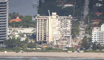 Aerial view shows the partially collapsed residential building in Surfside near Miami Beach, today.