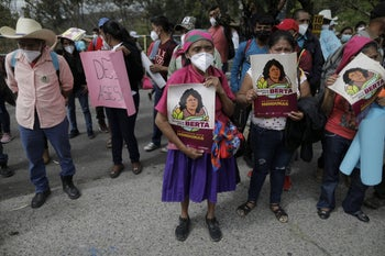 Supporters of prize-winning Honduran rights activist Berta Cáceres, outside the courtroom where the trial of her suspected murderer is being held, April 6, 2021.