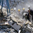 Rescue workers search in the rubble at the Champlain Towers South Condo